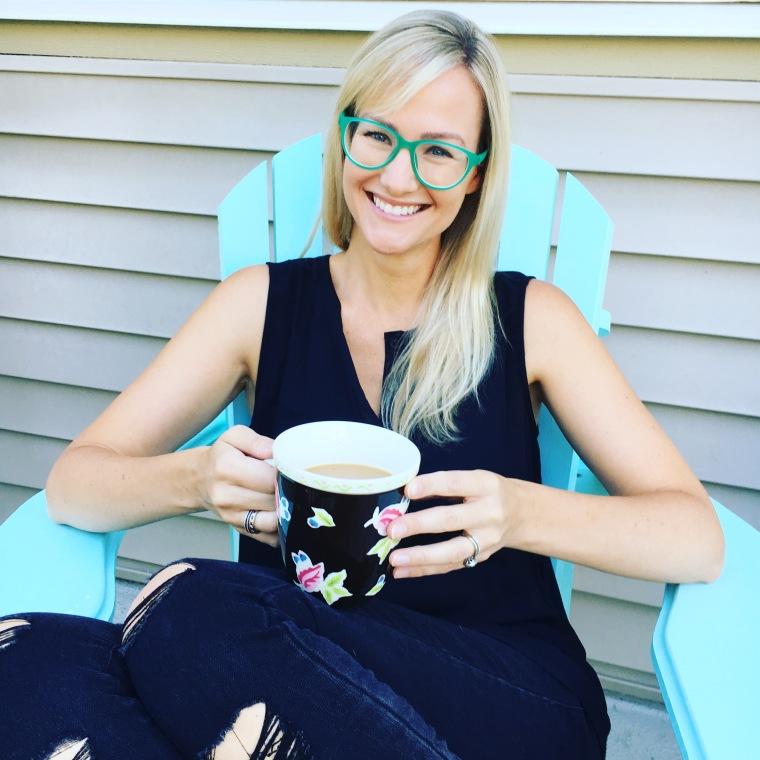 Black jeans, black tank, turquoise glasses
