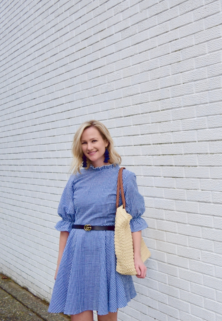 Blue gingham dress with straw bag